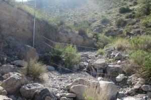 """barbed wire fence across """"Wrong Canyon"""""""
