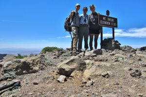 2013-06-21 2013-06-21 Mt Taylor 031 Jane Celia Me summit sign