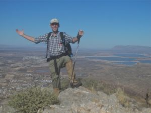 Author in requisite summit pose, Elephant Butte in background