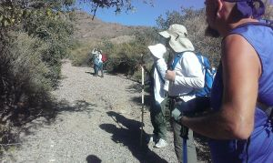 Hikers in arroyo in Ladera Canyon