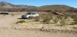The mighty Camry at the trailhead. Note tank to the left and hillock to the right.