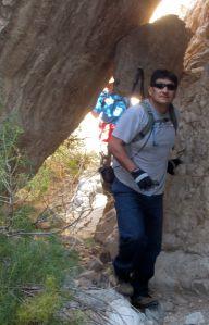 John beneath large slab just before the upper waterfall