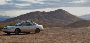 The mighty Camry at the west trailhead, Pichacho in background and berm on the right