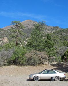 The mighty Camry in the Pine Shadows Campground, with false summit above.