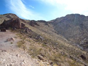 Jeep road ends at small wall (left) below ridge (top) and above gulch (right)