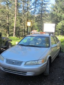 The mighty Camry, parked beneath signs for Trail 36 Big Bonito Creek