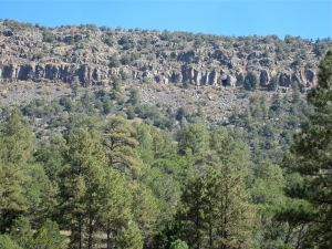 View of the wall protecting the mesa top, can you spot the cave?