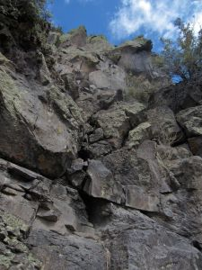 View of the crux move, looking up from the rubble pile at the base of the crux.