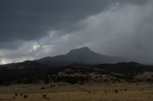 "A ""side view"" of Pedernal as it embraces the storm."