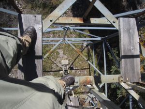 View through a tower platform that is missing boards