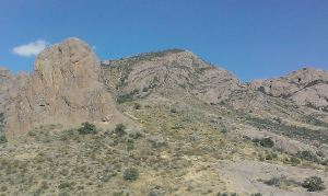 Chimney Rock (left) and distant Shark's Tooth Peak