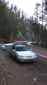 The mighty Camry, parked alongside NM-152 near the Railroad Canyon trailhead. The snow at this altitude only remained where it had been plowed.