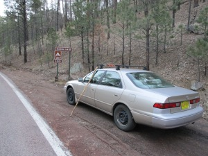 The mighty Camry in front of a sign for Railroad Campground