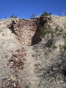 Half cut-away view into an old well on the side of the arroyo below the