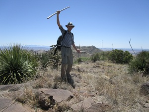The author on North Las Uvas summit, with the radar dome of Magdelana Peak in the background.
