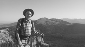 14 Author on flank of Lake Peak, Santa Fe baldy in background