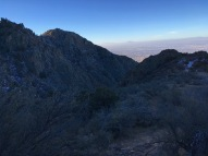06 Sun-touched south rim of Canon La Cueva, Mt Taylor on horizon