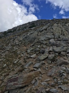 13 faint climbers tread on rib leading to main ridge