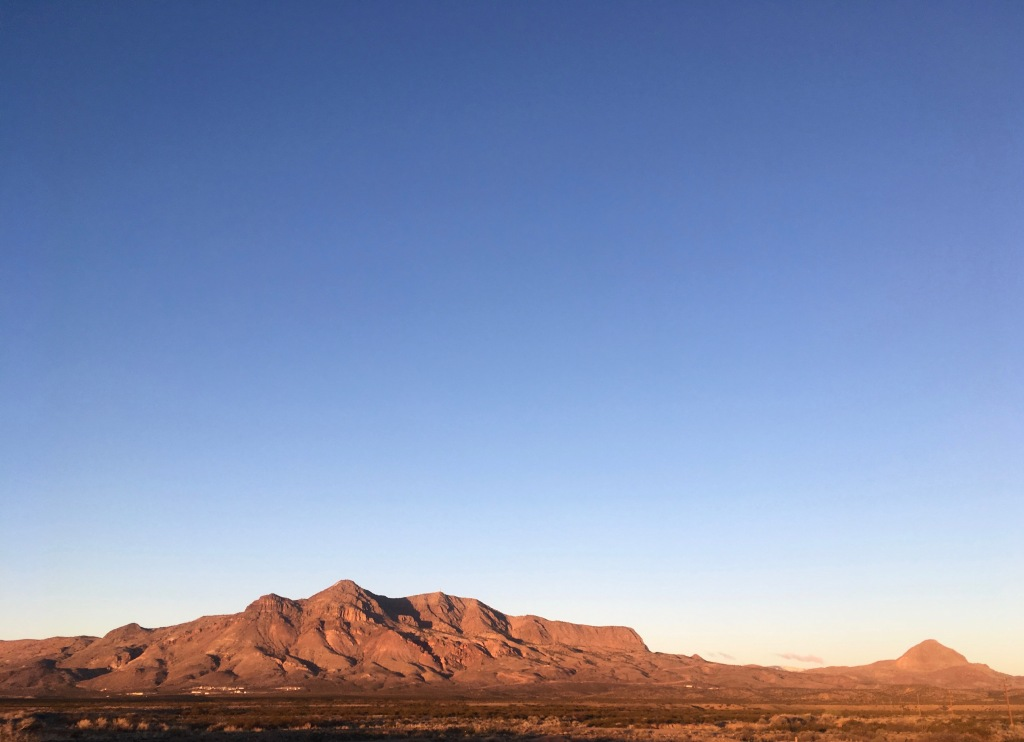 Socorro Mountains at dawn, Strawberry Peak on the right side and distant from the main block of mountains